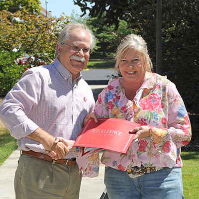 Lynette Kinzer receives award from Dean Slinker