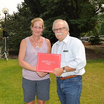 Kathleen Reed receives award from Dean Slinker
