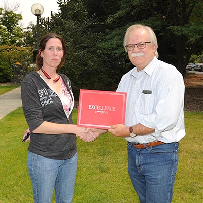 Lisa Jones receives award from Dean Slinker