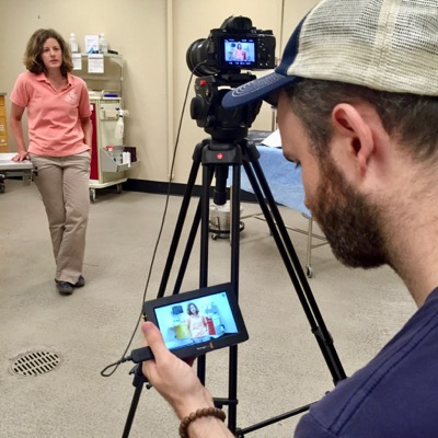 Program director Dr. Julie Cary works with film crew to create training videos