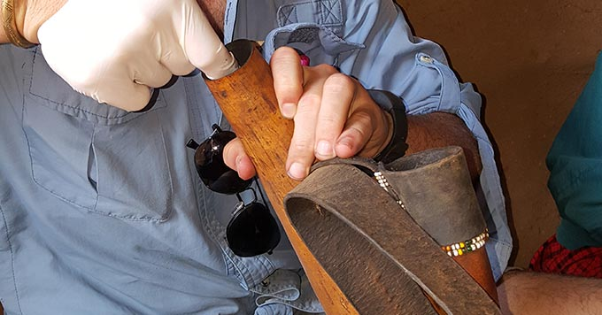 Dr. Mark Caudell, an anthropologist with the Allen School, swabs a calabash for bacteria.